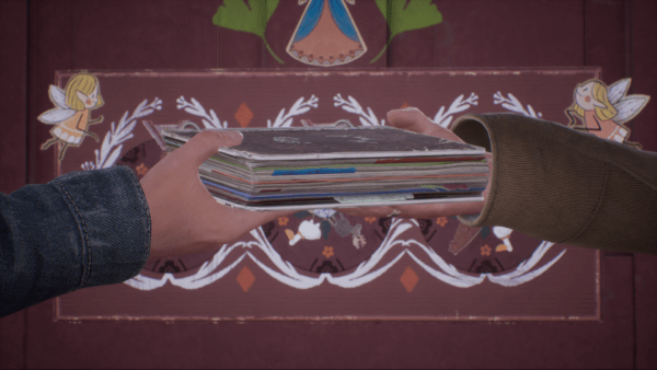 A close-up of Tyler's and Alyson's hands holding the Book of Goblins.