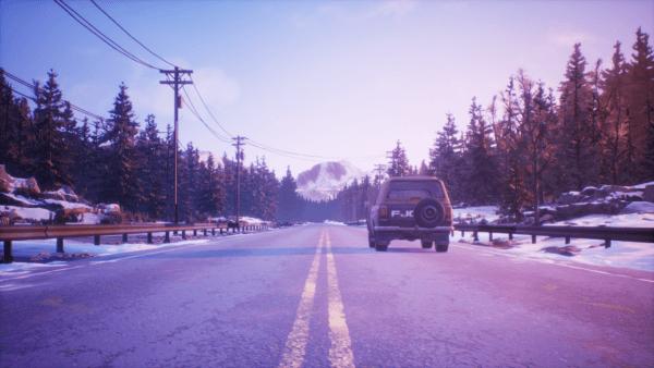 A car driving toward a mountain.
