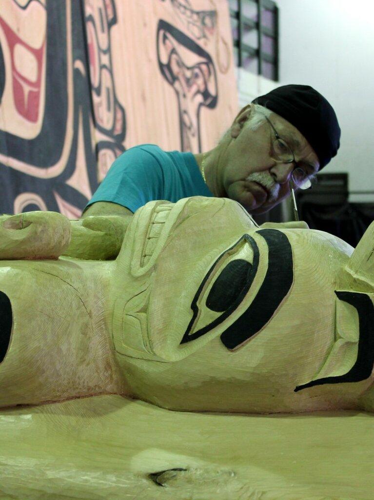 Gordon Greenwald, working on a totem.