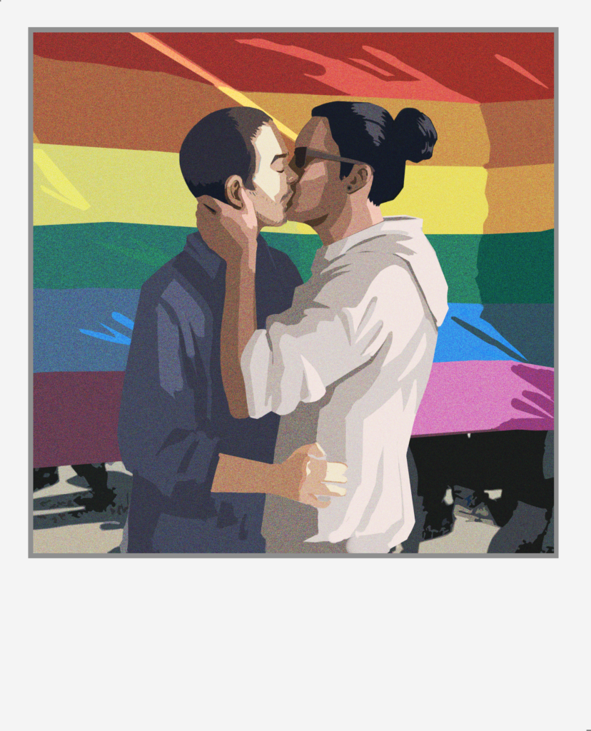 A photo of Tyler and Michael kissing in front of a rainbow flag.
